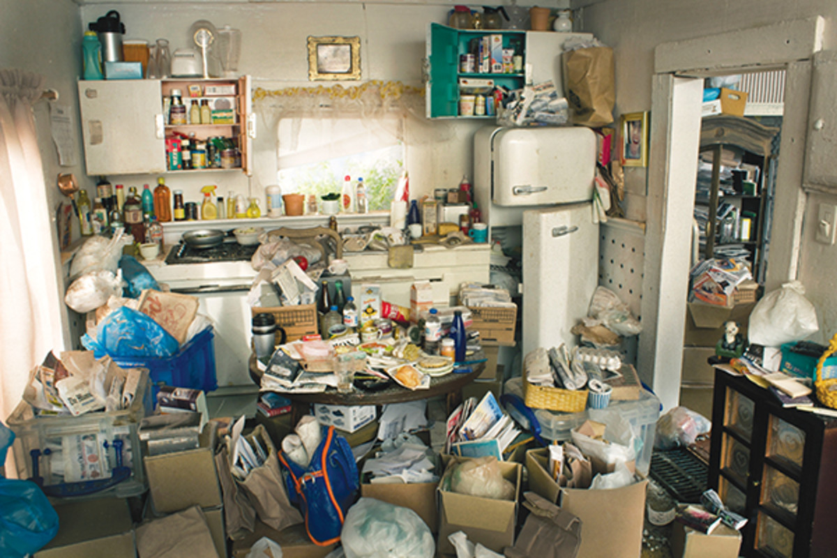 St. Louis-based artist and photographer Carrie M. Becker created a miniature diorama of a hoarder's house. Becker makes her work, she explains, as a