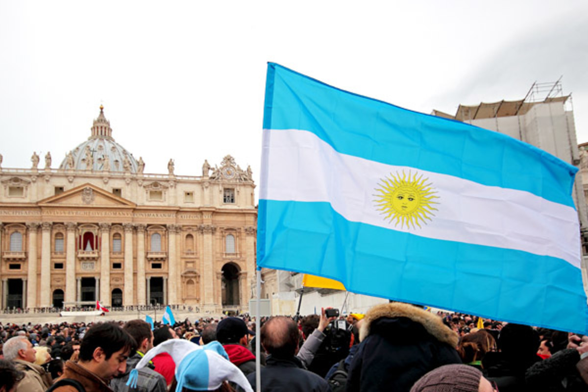 The flag of Argentina waves before the first Angelus prayer of Pope Francis, in Rome (PHOTO: MATTIATH/SHUTTERSTOCK)