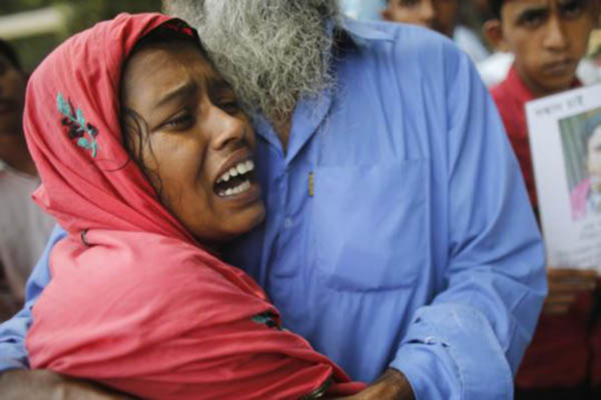 A woman mourns for her husband, a garment worker who had died in the collapse of the Rana Plaza building, in Savar, around 19 miles outside Dhaka, Bangladesh. (PHOTO: REUTERS)