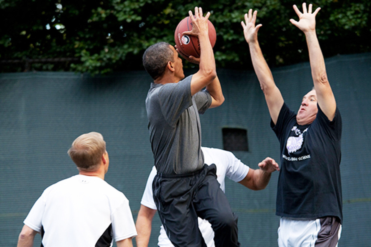 Obama taking a shot during a game on the White House basketball court. (PHOTO: PUBLIC DOMAIN)