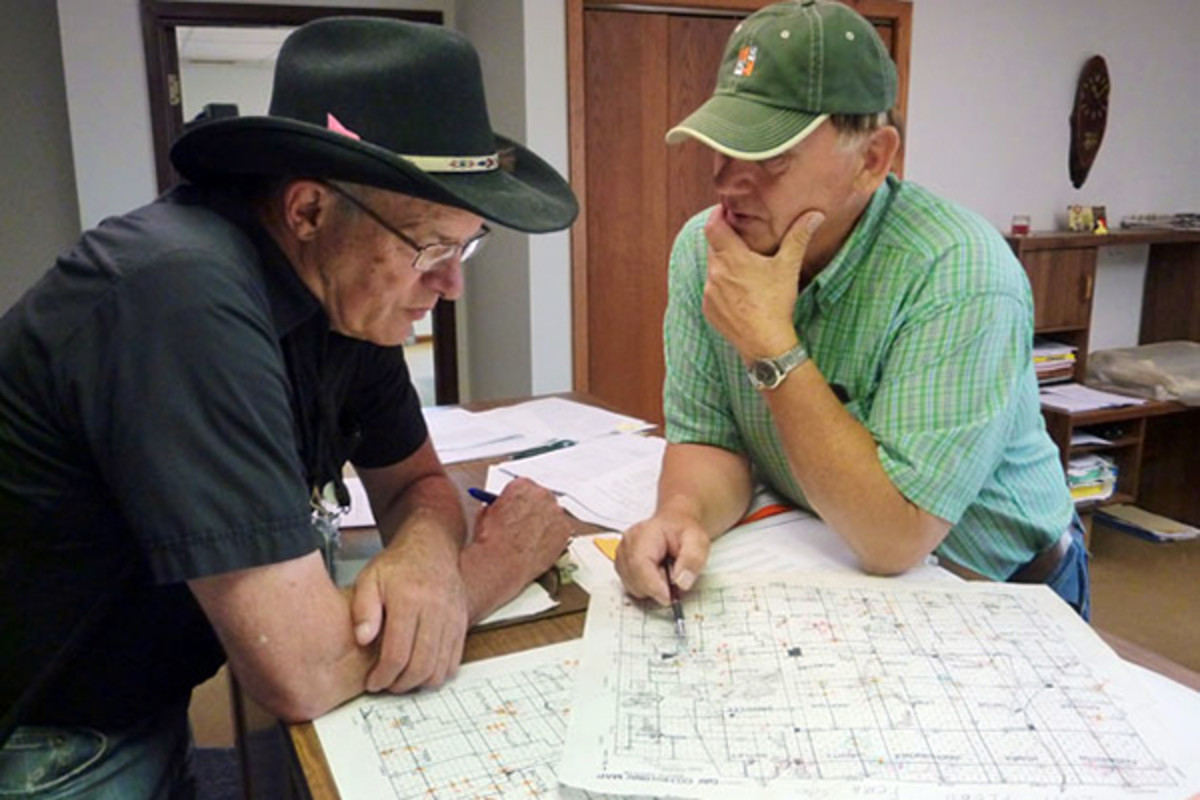 FEMA Public Assistance Coordinator Jim Russell (left) and Day County S.D. Highway Supervisor Chuck Fromelt review South Dakota flood damage in 2011. (PHOTO: FEMA PHOTO LIBRARY)