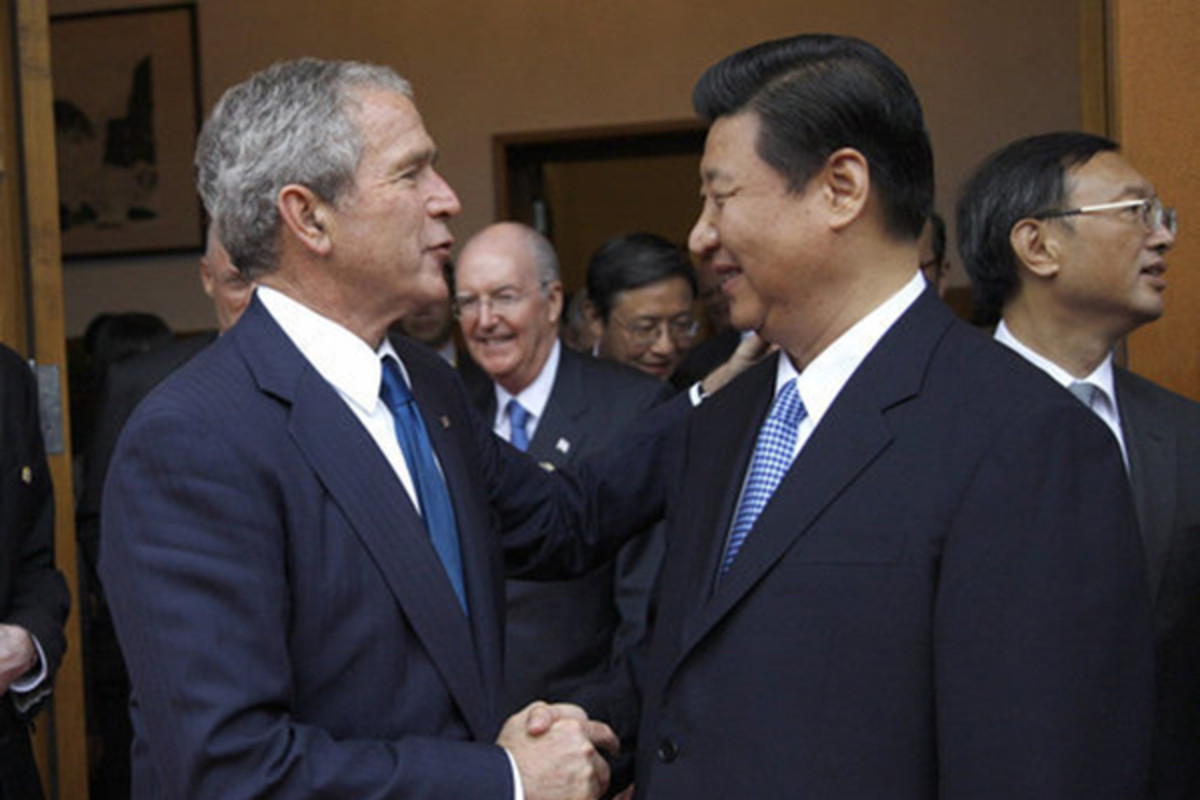 Xi Jinping greeting U.S. President George W. Bush in August 2008. (PHOTO: PUBLIC DOMAIN)
