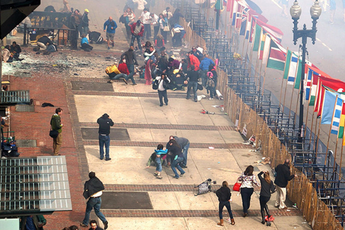 Immediate aftermath of the first blast (within 10 seconds) of the Boston Marathon bombings. (PHOTO: AARON TANG/WIKIMEDIA COMMONS)
