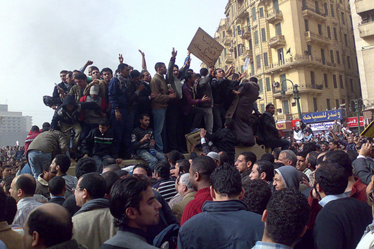 Protesters on an army vehicle during the 2011 Egyptian Revolution in Tahrir Square. (PHOTO: RAMY RAOOF/WIKIMEDIA COMMONS)