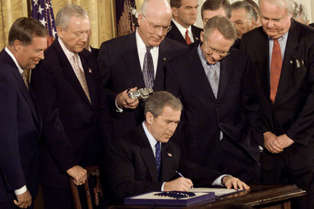 President George W. Bush signing the Patriot Act in the White House's East Room on October 26, 2001. (PHOTO: PUBLIC DOMAIN)