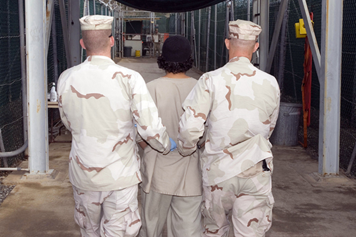 Captive being escorted at Guantanamo Bay. (PHOTO: PUBLIC DOMAIN)