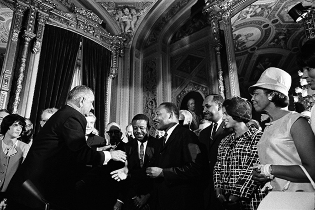 President Johnson, Martin Luther King, Jr., and Rosa Parks at the signing of the Voting Rights Act on August 6, 1965. (PHOTO: PUBLIC DOMAIN)