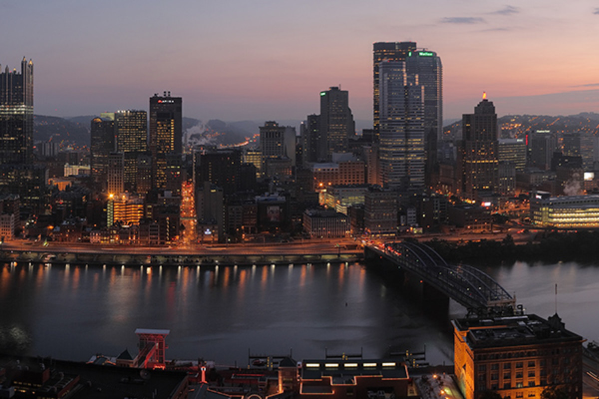The city of Pittsburgh at dawn, as seen from Mt. Washington. The Monongahela River is in the foreground. (PHOTO: MATTHEW FIELD/WIKIMEDIA COMMONS)
