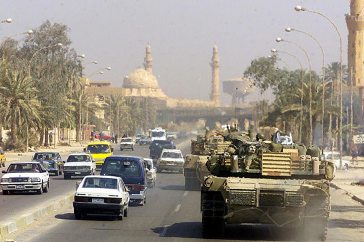 A Marine Corps M1 Abrams tank patrols a Baghdad street after its fall in 2003 during Operation Iraqi Freedom. (PHOTO: PUBLIC DOMAIN)