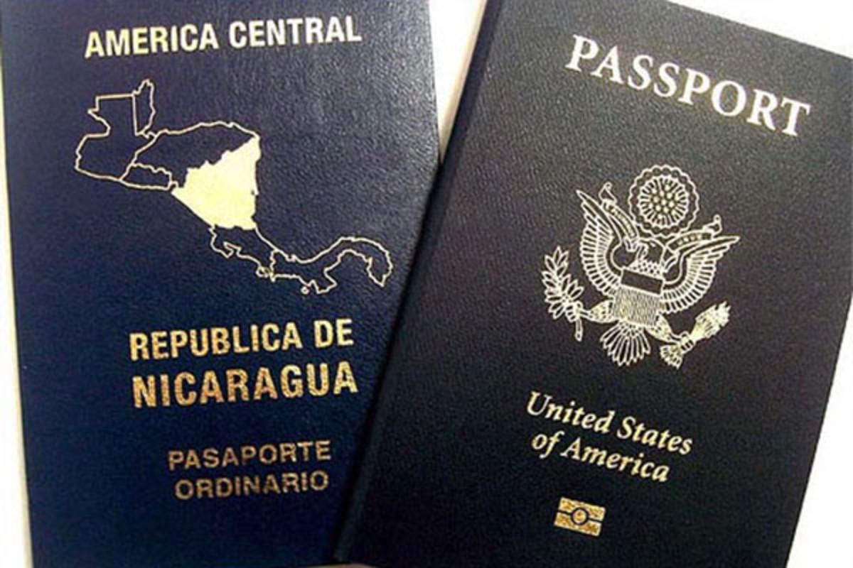 A dual citizen may bear two passports. (PHOTO: LANICOYA-/WIKIMEDIA COMMONS)