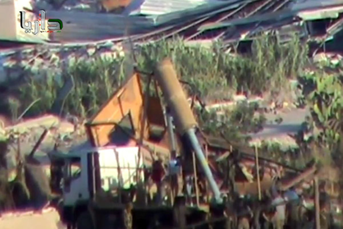 Still from a video that Syrian rebel forces claim is government soldiers firing rockets filled with chemical payloads. (PHOTO: YOUTUBE)