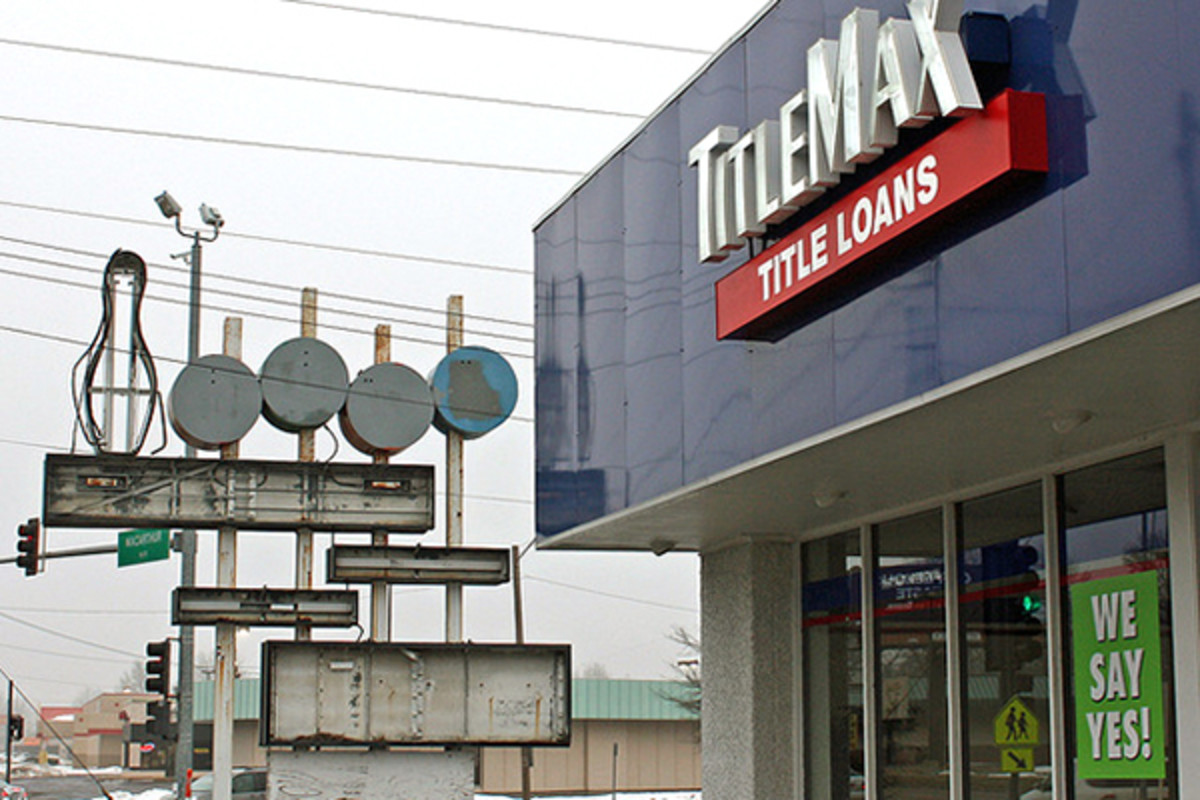 TitleMax, one of the fastest growing high-cost lenders in the country, has found a clever way around laws passed by several Texas cities: offer an initial loan at zero percent interest. This photo is of a TitleMax location in Springfield, Illinois (PHOTO: RANDY VON LISKI/FLICKR)