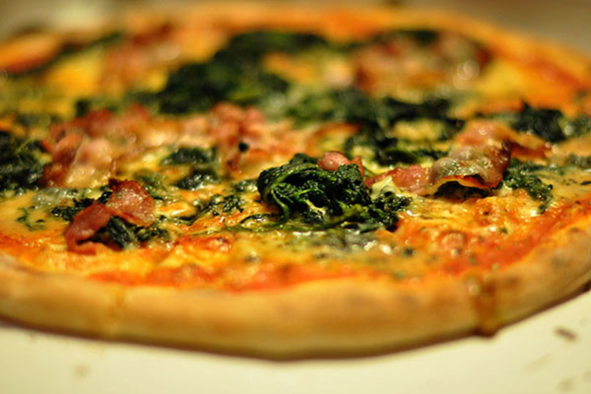 A pizza with gorgonzola cheese, spinach and bacon. (PHOTO: CYCLONEBILL/FLICKR)