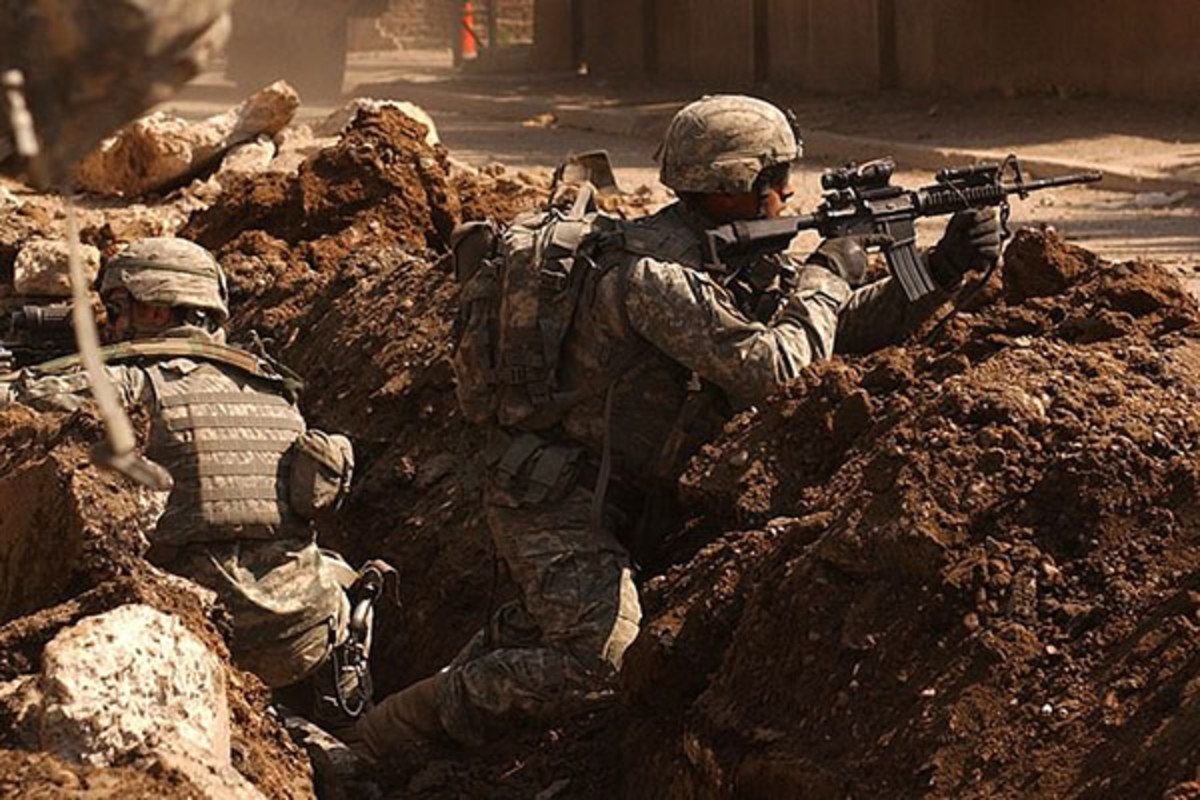 U.S. soldiers take cover during a firefight with insurgents in the Al Doura section of Baghdad. (PHOTO: PUBLIC DOMAIN)