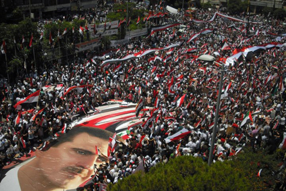 Pro-Assad demonstration in Lattakia, 2011. (PHOTO: SAMMY.AW/WIKIMEDIA COMMONS)