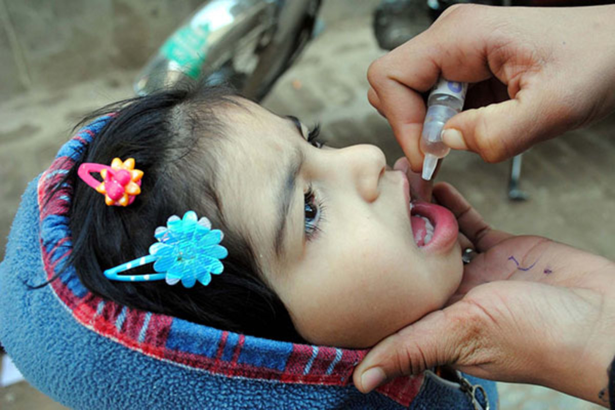 A child receiving an oral polio vaccine. (PHOTO: ASIANET-PAKISTAN/SHUTTERSTOCK)