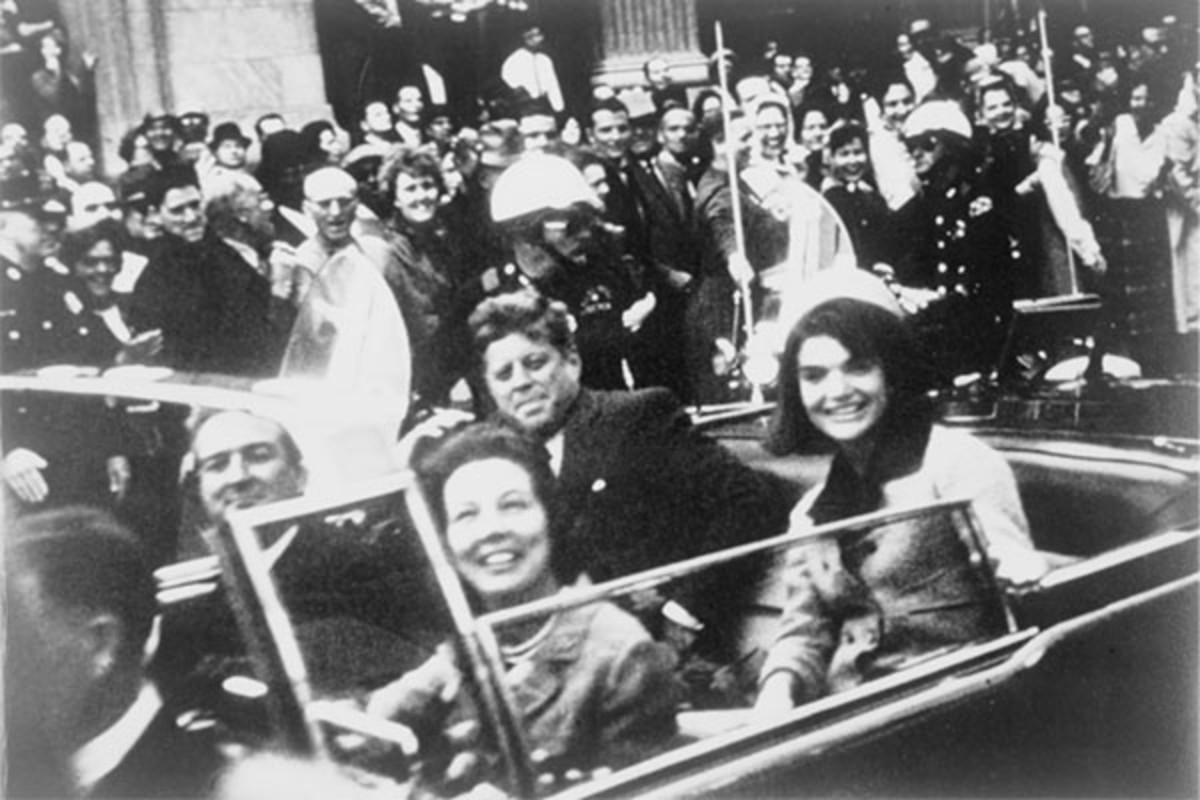 John and Jackie Kennedy in the presidential limousine before the assassination. (PHOTO: PUBLIC DOMAIN)