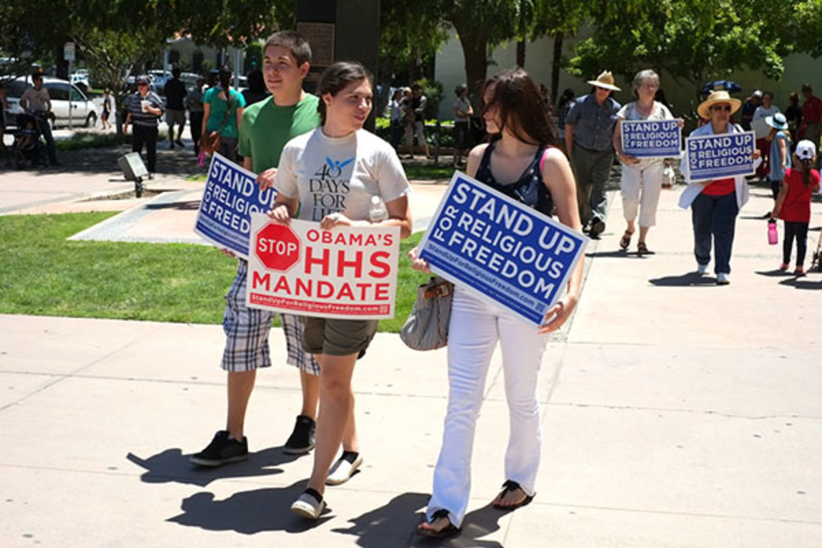 Unidentified participants show protest signs at the Stand Up for Religious Freedom Rally to object to the HHS health care mandate on June 8, 2012, in Bakersfield, California. (PHOTO: RICHARD THORNTON/SHUTTERSTOCK)