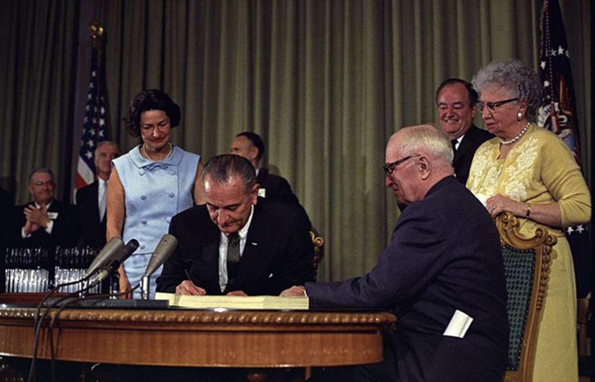 President Johnson signing the Medicare amendment. (Photo: Public Domain)