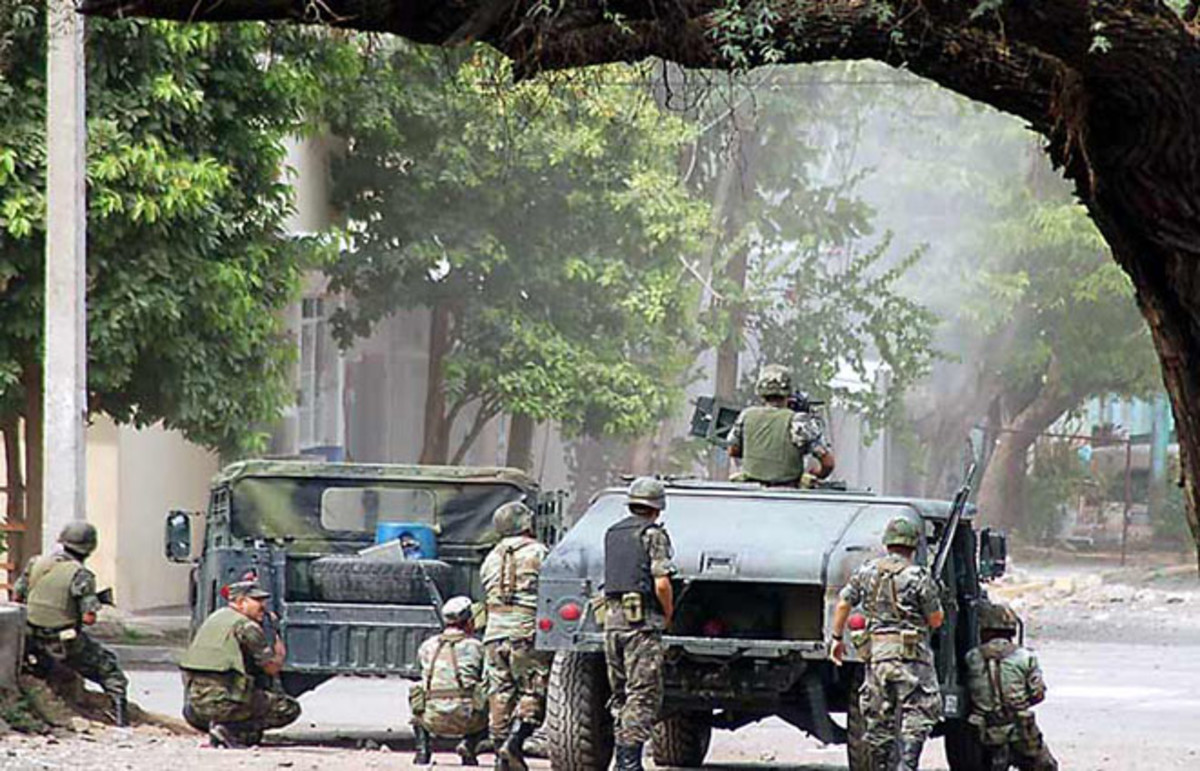 Mexican Army soldiers during a confrontation in Michoacán in August 2007. (Photo: Public Domain)