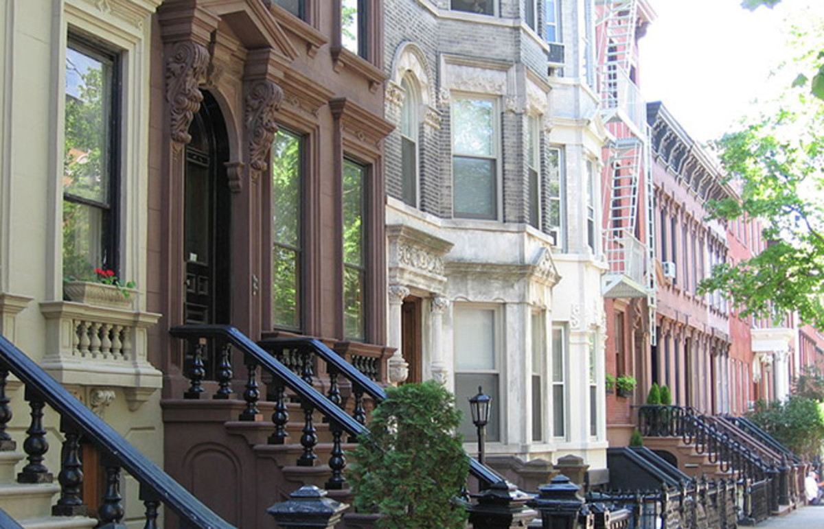 Landmark 19th-century rowhouses on tree-lined Kent Street in Greenpoint Historic District. (Photo: Public Domain)