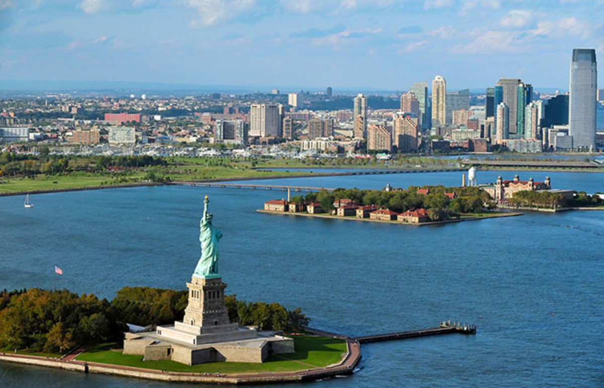 Aerial view of the Statue of Liberty and Ellis Island. (Photo: ChameleonsEye/Shutterstock)