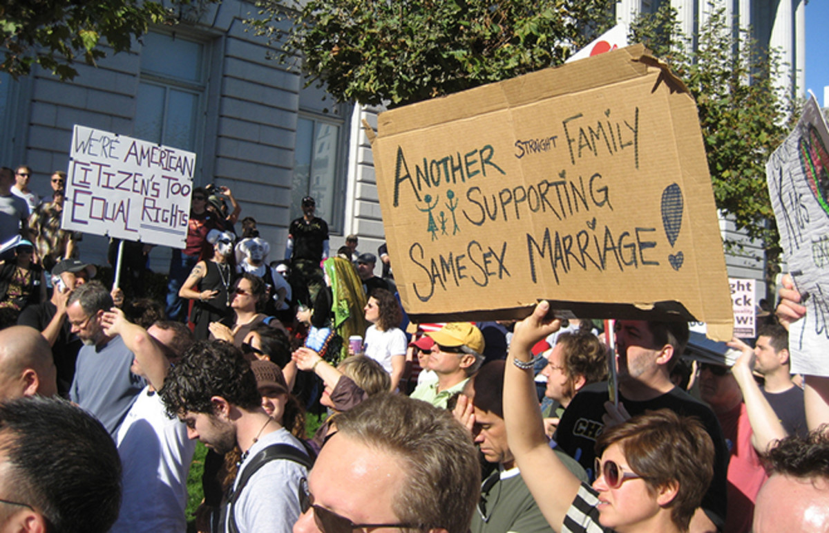 At a gay-rights rally, a straight family supports same-sex marriage. (Photo: dannyman/Flickr)