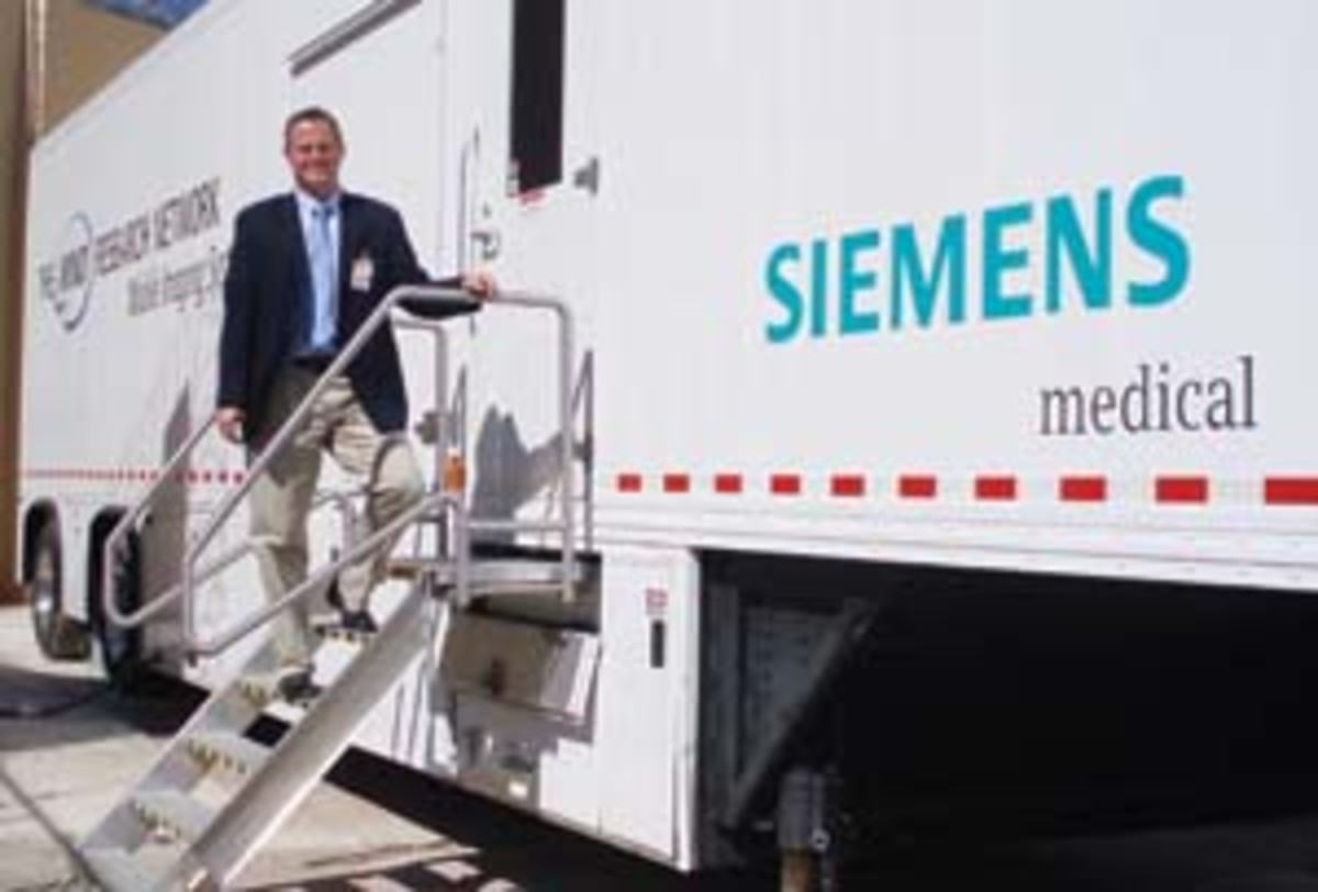 Kent Kiehl in front of the semi-trailer that houses a portable MRI scanner at the Western New Mexico Correctional Facility. Click the image to see a cutaway of the trailer and one view of the scanner.