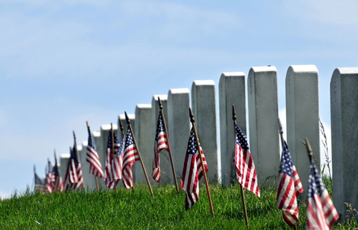 Gravestones decorated with U.S. flags to commemorate Memorial Day at the Arlington National Cemetery in Arlington, Virginia. (Photo: Frontpage/Shutterstock)