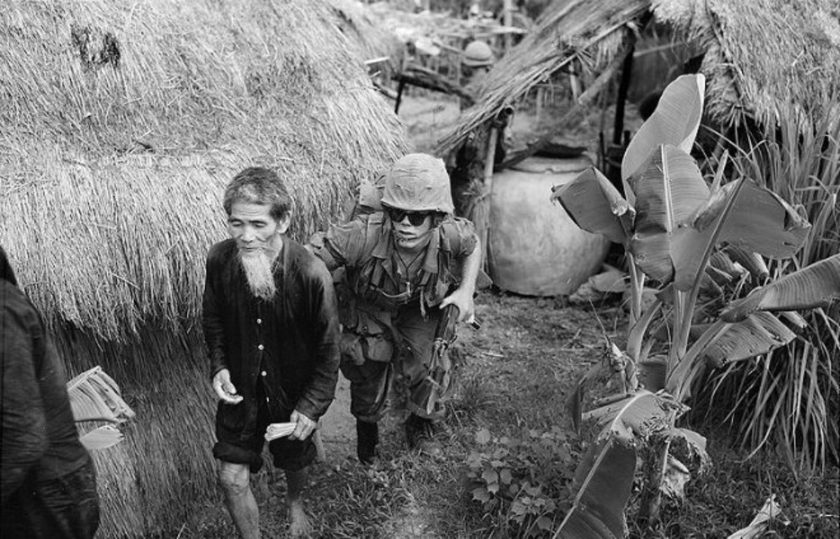 A U.S. Marine moves a Viet Cong suspect, 1965. (Photo: Wikimedia Commons/Marine Corps)