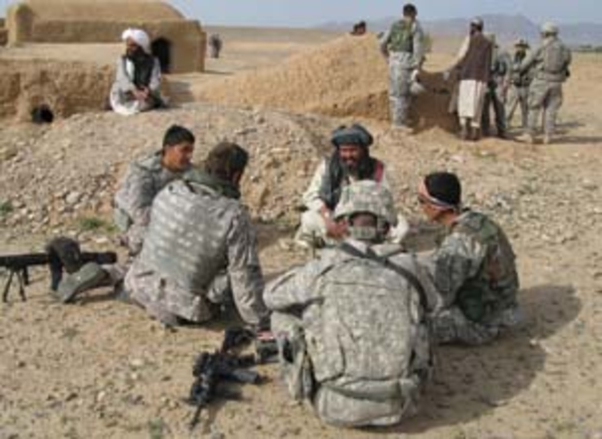 U.S. soldiers and Human Terrain Team members speak to an elder in a southern Afghanistan village. (Vanessa M. Gezari)