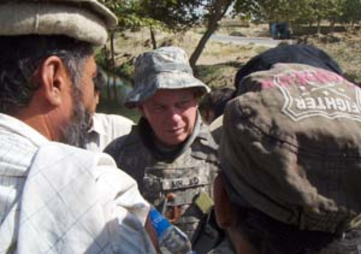 During a Human Terrain System mission, Ed Campbell talks in a village in southern Afghanistan.
