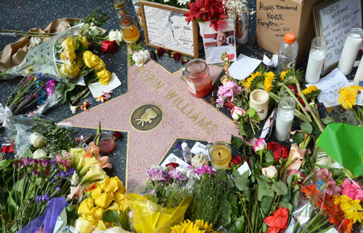 Robin Williams' star on the Hollywood Walk of Fame is surrounded by flowers and various memorial tributes left by fans on August 12, 2014. (Photo: Dan Holm/Shutterstock)