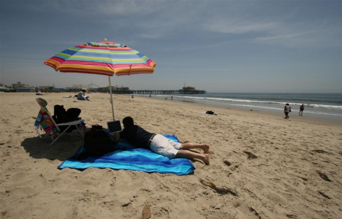 I've just got to answer my emails, then I can enjoy the beach, the city, and the bars. (Photo: davemcom/Flickr)