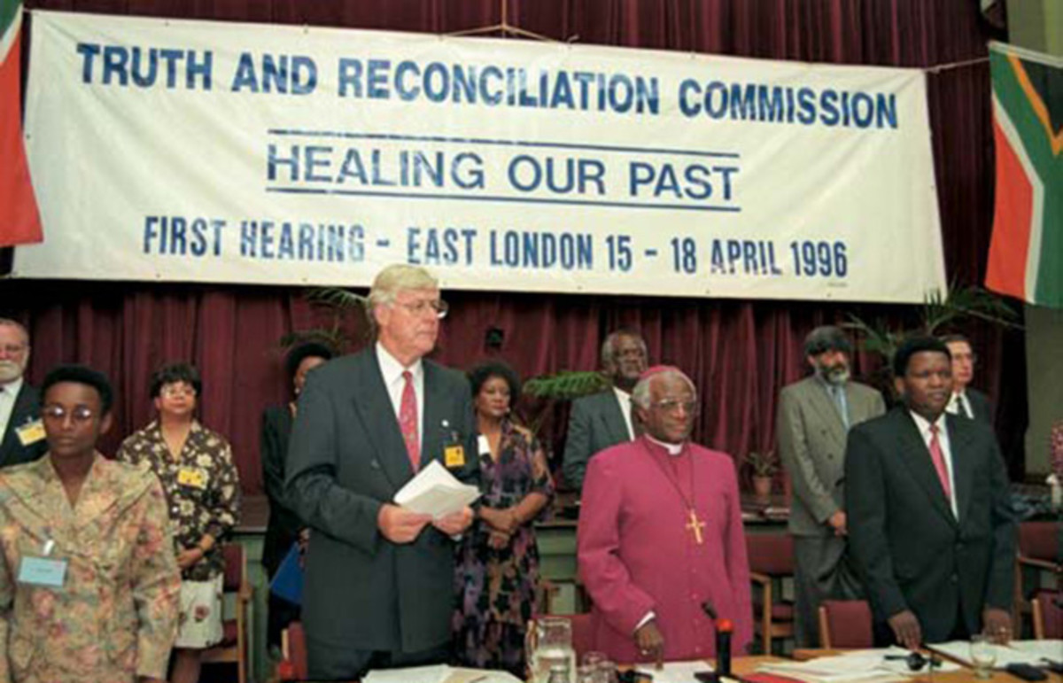 Members of South Africa's Truth and Reconciliation Commission at its first hearing in April 1996. (Photo: Benny Gool/Desmond Tutu Peace Centre)