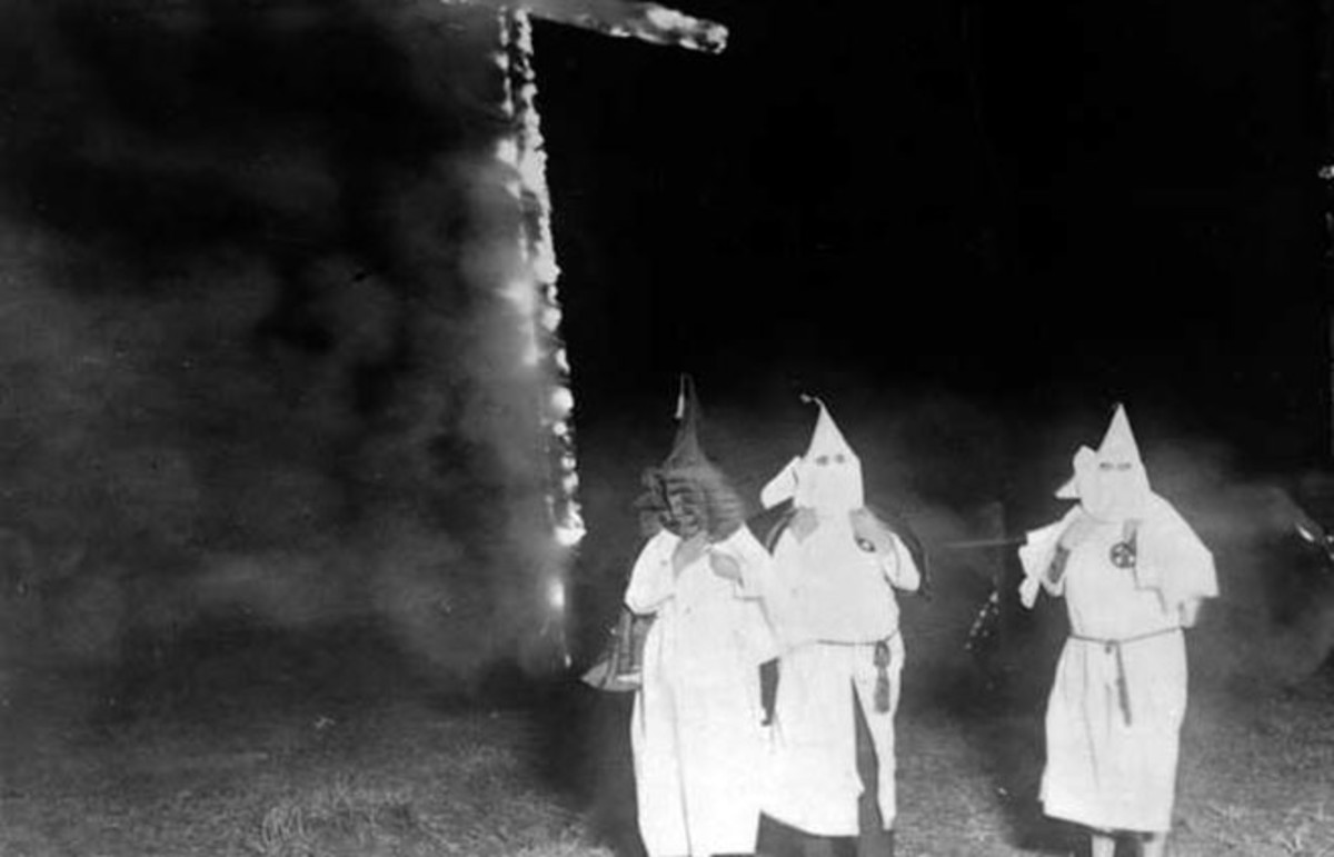 Ku Klux Klan members and a burning cross, Denver, Colorado, 1921. (Photo: The Library of Congress)