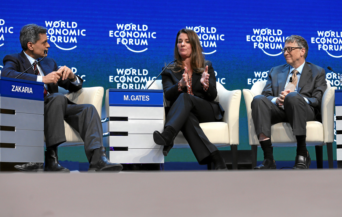 Fareed Zakaria talks sustainable development with Melinda and Bill Gates at Davos. (Photo: World Economic Forum/Flickr)