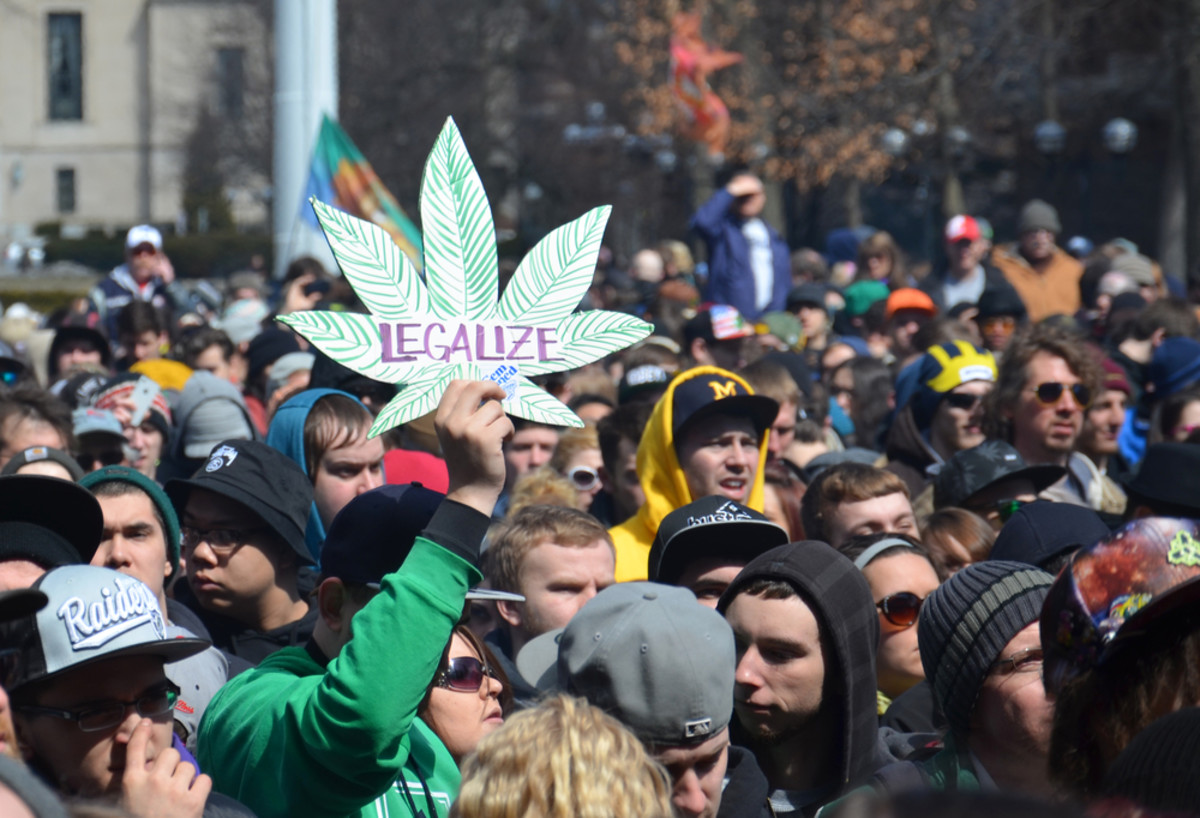 A participant holds up a sign at the 43rd annual Hash Bash rally in Ann Arbor, Michigan, on April 5, 2014. (Photo: Susan Montgomery/Shutterstock)