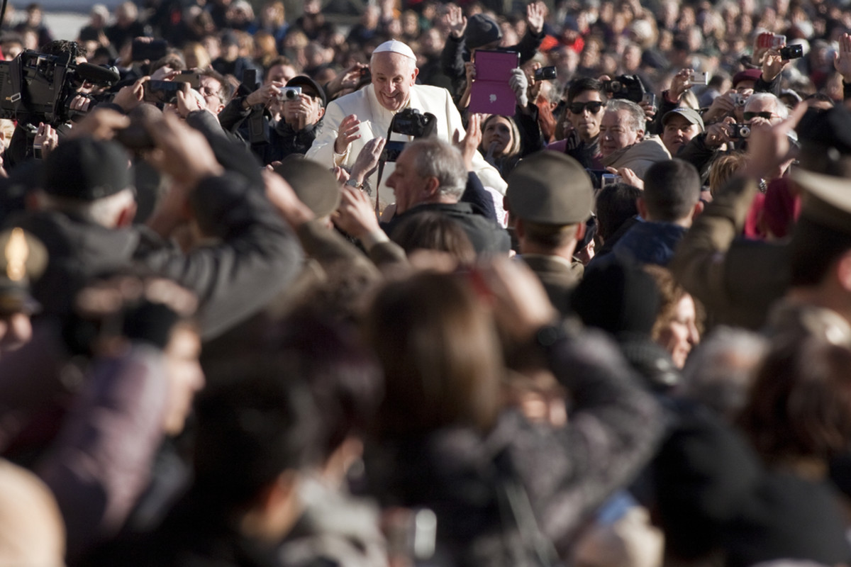Pope Francis greets the pilgrims during his weekly general audience in St Peter's Square at the Vatican on December 04, 2013. (Photo: giulio napolitano/Shutterstock)