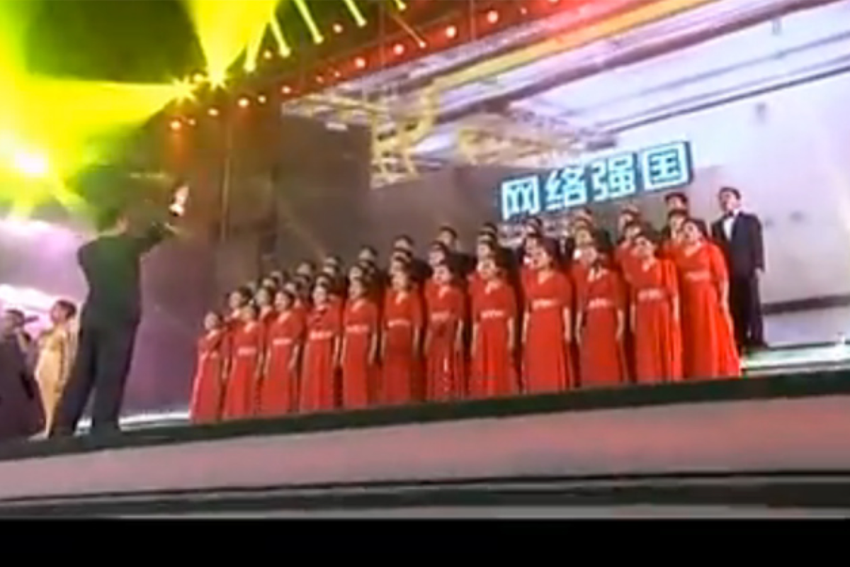 "Employees of China's Cyberspace Administration perform a choral anthem, a song titled ""The Mind and Spirit of Cyberspace Security."" (Photo: YouTube)"