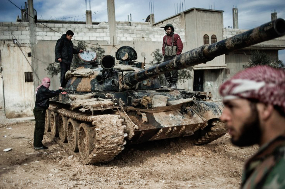 A Free Syrian Army member prepares to fight with a tank whose crew defected from government forces in al-Qusayr, Syria. (Photo: Freedom House/Flickr)