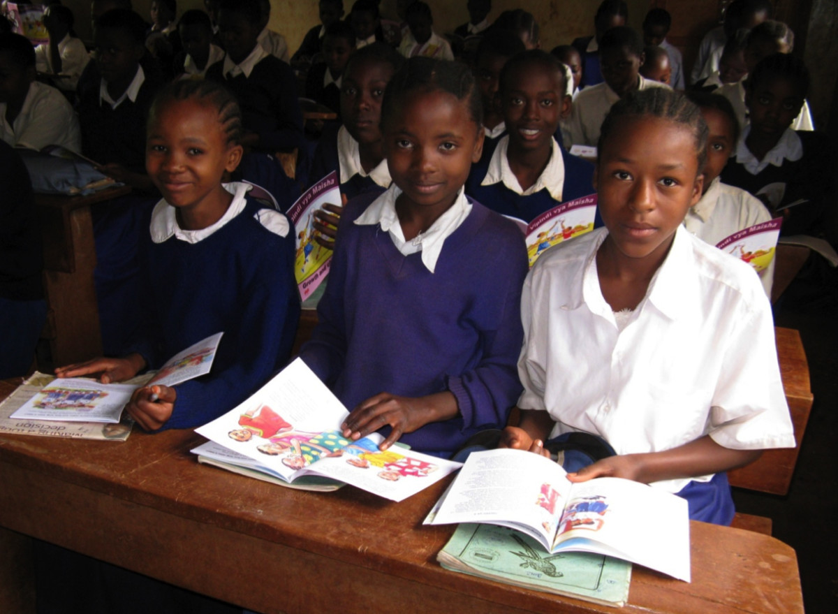 Girls in Africa reading the puberty books, which include information on menstrual management, that Marni Sommer developed with  her non-profit. (Photo: Marni Sommer)