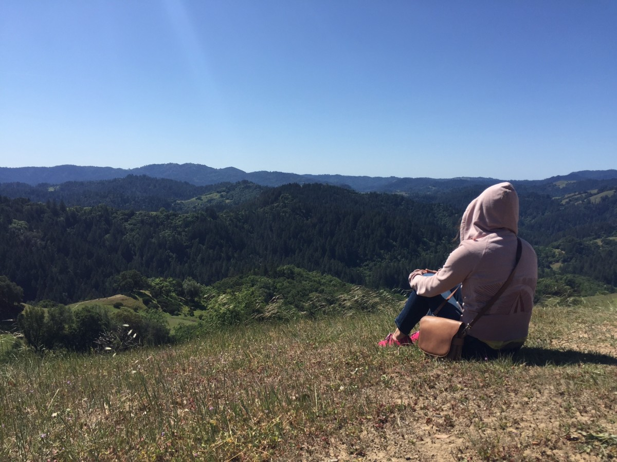The author looks out from a bluff in Armstrong Redwoods State Natural Reserve. (Photo: Courtesy of Alexis Coe.)