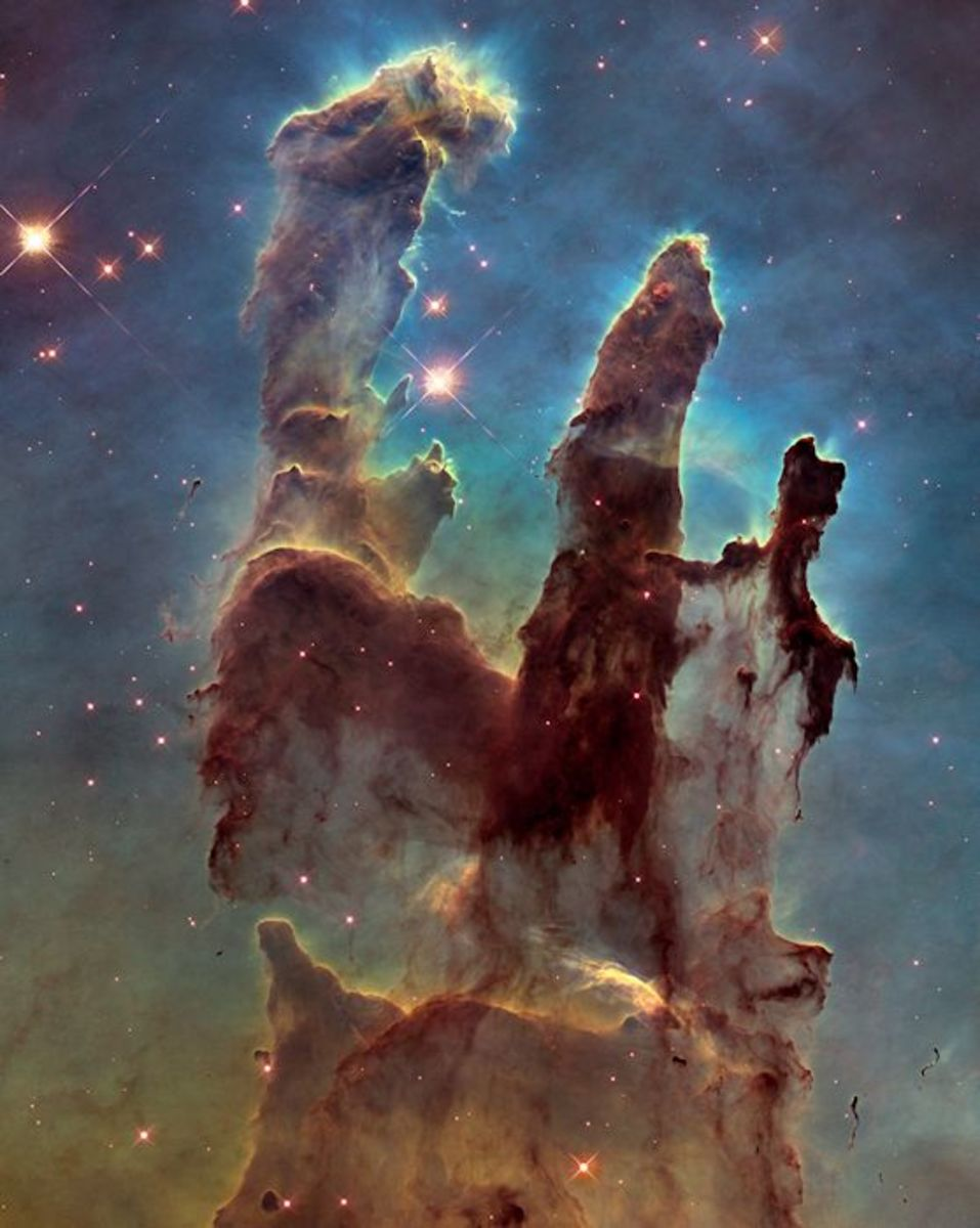 """Pillars of Creation,"" showing a part of the Eagle Nebula. (Photo: NASA/ESA/Hubble Heritage Team/J. Hester, P. Scowen)"