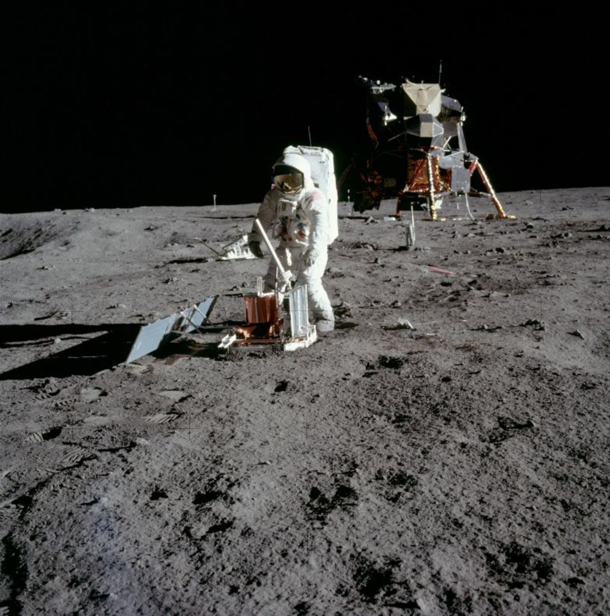Buzz Aldrin deploys a seismometer in the Sea of Tranquillity. (Photo: NASA)