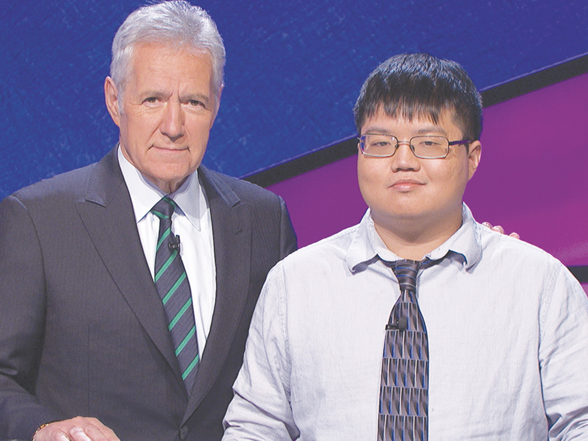 Host Alex Trebek poses with champion Arthur Chu, who both delighted and appalled TV viewers with an aggressive force on maximizing cash. (Photo: Sony Studios)