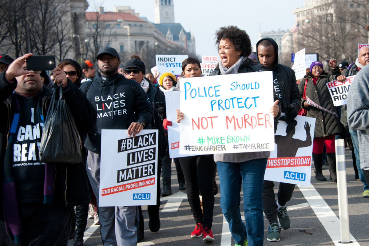 Protesters march against police shootings and racism during a rally in   Washington, D.C., on December 13, 2014. (Photo: Rena Schild/Shutterstock)