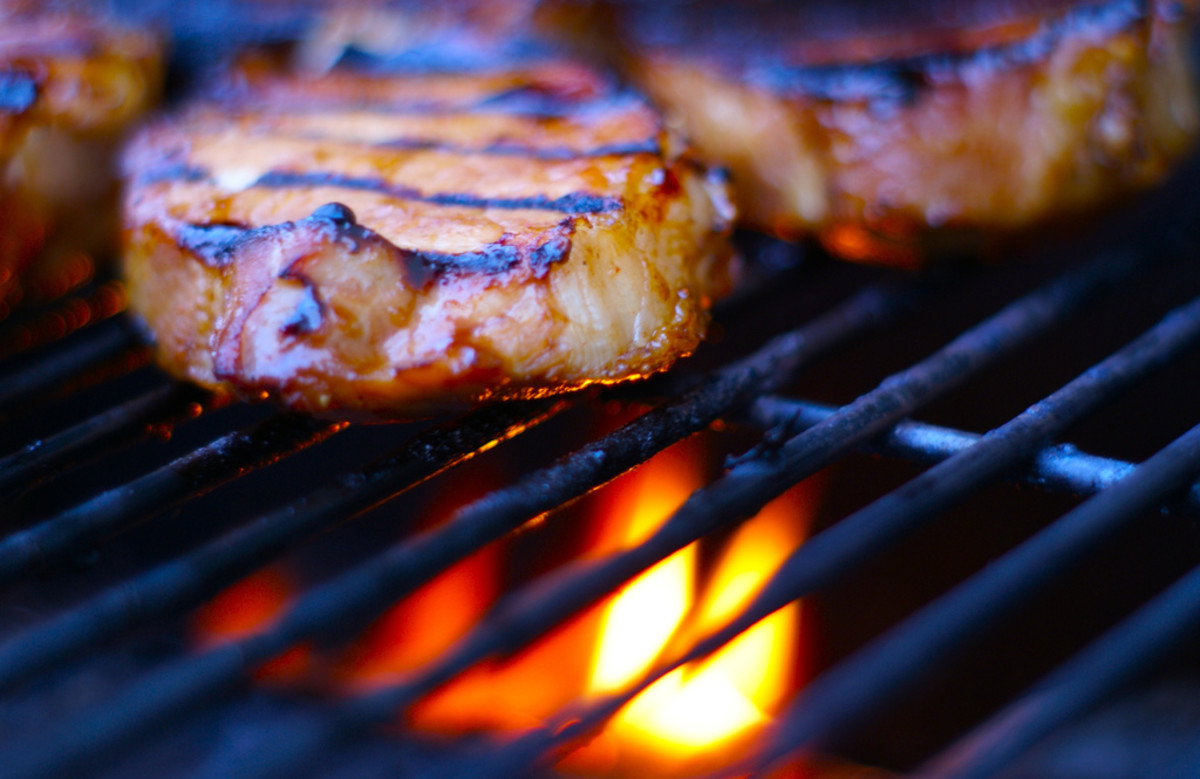 Pork chops—i.e. death on a grill. (Photo: Christopher Aloi/Flickr)