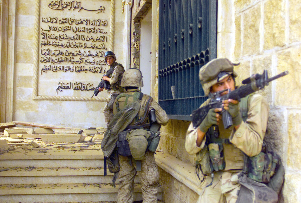 U.S. Marines enter a palace during the Fall of Baghdad. (Photo: Wikimedia Commons)