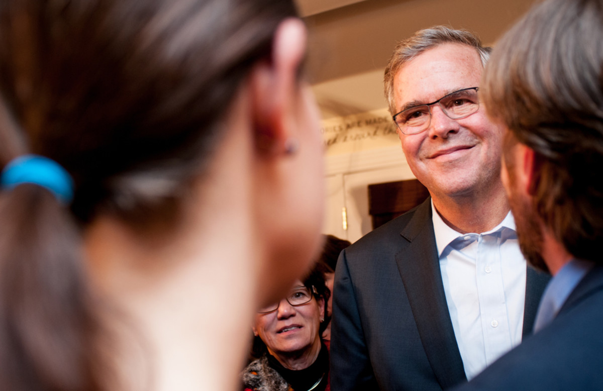 Former Florida Governor Jeb Bush speaks with voters in Dover, New Hampshire, on March 17, 2015. (Photo: Andrew Cline/Shutterstock)